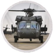 A Uh-60 Black Hawk Taxis Round Beach Towel by Terry Moore
