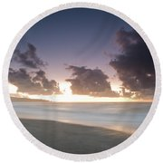 A Beach During Misty Sunset With Glowing Sky Round Beach Towel