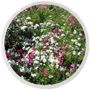 A Bed Of Beautiful Different Color Flowers Round Beach Towel