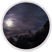 A Bright Moon Rises Through Clouds Round Beach Towel