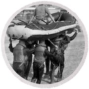 A Buds 1st Phase Boat Crew Carry An Round Beach Towel
