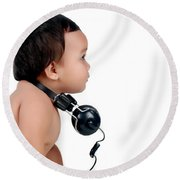 A Chubby Little Girl With Headphones Round Beach Towel