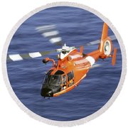 A Coast Guard Hh-65a Dolphin Rescue Round Beach Towel by Stocktrek Images