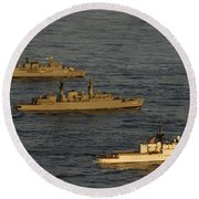 A Convoy Of Naval Ships Move Round Beach Towel