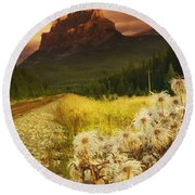 A Country Road With A Mountain In The Round Beach Towel