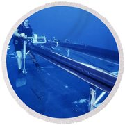 A Crewman Cranks Out The Dry Deck Round Beach Towel by Michael Wood