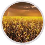 A Field Of Canola With A Rainbow Round Beach Towel