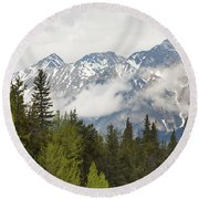 A Forest And The Rocky Mountains Round Beach Towel