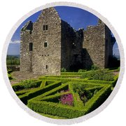 A Garden In Front Of Tully Castle Near Round Beach Towel