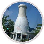 A Giant Milk Bottle In Spokane Round Beach Towel