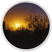 A Golden Saguaro Sunrise Round Beach Towel