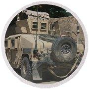 A Humvee Patrols The Streets Of Kunduz Round Beach Towel
