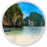 A Long Tail Boat By The Beach In Thailand  Round Beach Towel