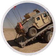 A M1114 Armored Vehicle Is Unloaded Round Beach Towel
