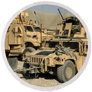 A M1114 Humvee Sits Parked In Front Round Beach Towel