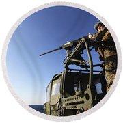 A Machine Gunner Mounts A M-2 Round Beach Towel by Stocktrek Images