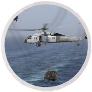 A Mh-60s Knighthawk Transfers Cargo Round Beach Towel by Gert Kromhout