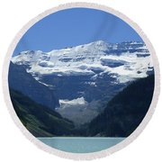 A Mountain Range With A Lake In The Round Beach Towel