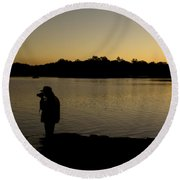 A Photographer At Work During Sunset Over A Lake Round Beach Towel
