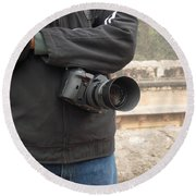 A Photographer With His Digital Camera On Location At A Historical Monument Round Beach Towel