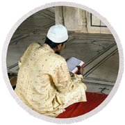 A Pious Devotee Reading The Quran Inside The Jama Masjid In Delhi Round Beach Towel