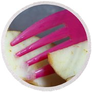 A Plastic Fork Being Used To Cut Into A Piece Of Cut Apple Pieces Round Beach Towel
