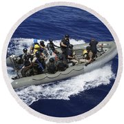 A Rigid-hull Inflatable Boat Carrying Round Beach Towel by Stocktrek Images