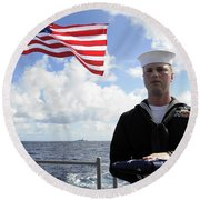 A Sailor Carries The National Ensign Round Beach Towel