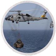 A Sh-60j Seahawk Transfers Cargo Round Beach Towel