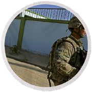 A Soldier Patrols The Streets Of Qalat Round Beach Towel
