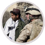 A Soldier Talks To A Local Villager Round Beach Towel
