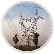 A Transmission Tower Carrying Electric Lines In The Countryside Round Beach Towel
