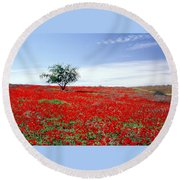 A Tree In A Red Sea Round Beach Towel