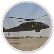A Uh-60 Black Hawk Landing Round Beach Towel