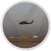A Uh-60 Blackhawk Helicopter Flies Round Beach Towel