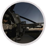 A Uh-60l Blackhawk Door Gunner Mans Round Beach Towel