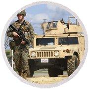 A U.s. Marine Guides A Humvee Round Beach Towel