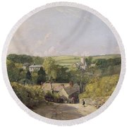 A View Of Osmington Village With The Church And Vicarage Round Beach Towel
