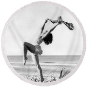 A Woman Dancing On The Shore Round Beach Towel