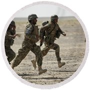 Afghan National Army Soldiers Run Round Beach Towel