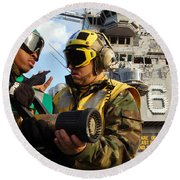 Airman Receives Proper Fire Fighting Round Beach Towel by Stocktrek Images