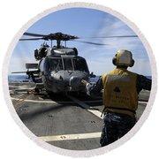 Airman Signals To An Mh-60s Sea Hawk Round Beach Towel