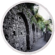 Alley With Arches Round Beach Towel