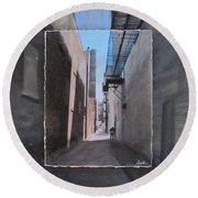 Alley With Guy Reading Layered Round Beach Towel by Anita Burgermeister