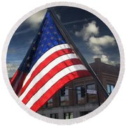 American Flag Flowing In Urban Landscape Round Beach Towel