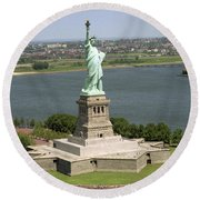 An Aerial View Of The Statue Of Liberty Round Beach Towel