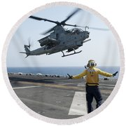 An Ah-1z Cobra Helicopter Takes Round Beach Towel