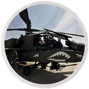 An Ah-64d Apache Helicopter Parked Round Beach Towel