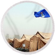 An Air Force Flag In Tent City Waves Round Beach Towel