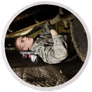 An Airman Inspects The Undercarriage Round Beach Towel by Stocktrek Images